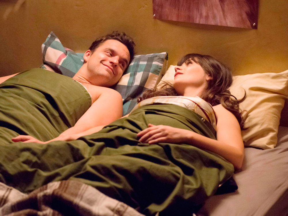 New Girl's Jess and Nick in bed after sex.