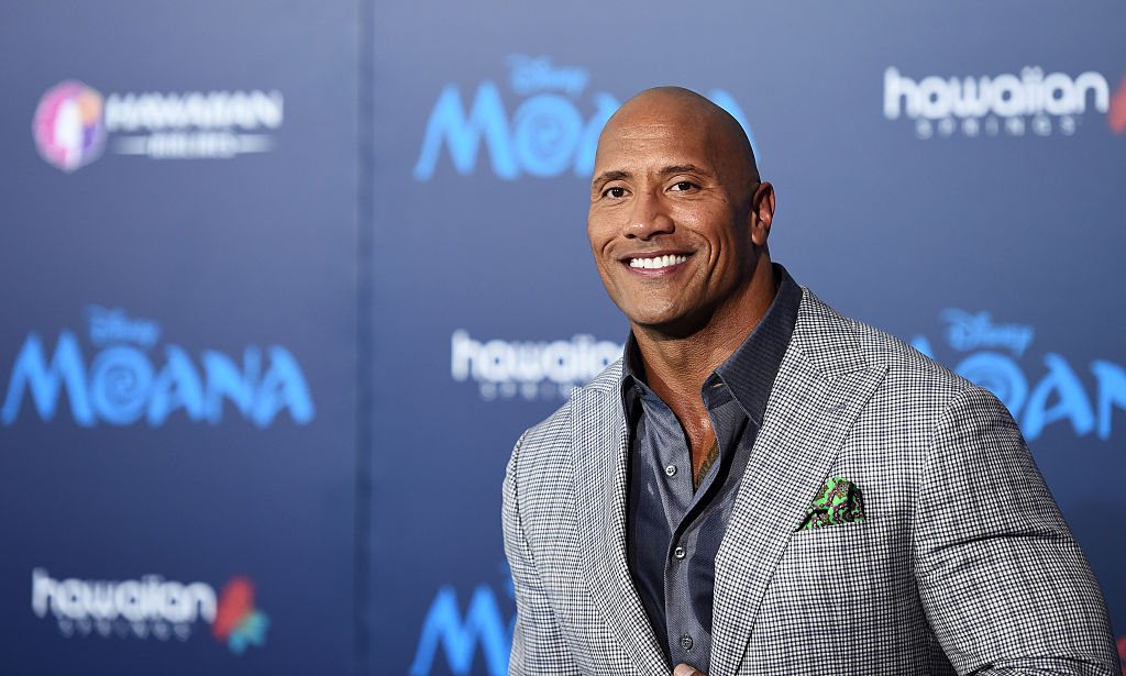 the rock gray suit smiling red carpet
