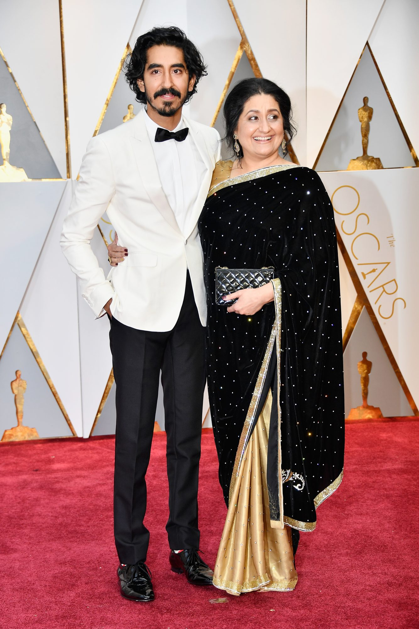 HOLLYWOOD, CA - FEBRUARY 26:  Actor Dev Patel (L) and Anita Patel attend the 89th Annual Academy Awards at Hollywood & Highland Center on February 26, 2017 in Hollywood, California.  (Photo by Frazer Harrison/Getty Images)