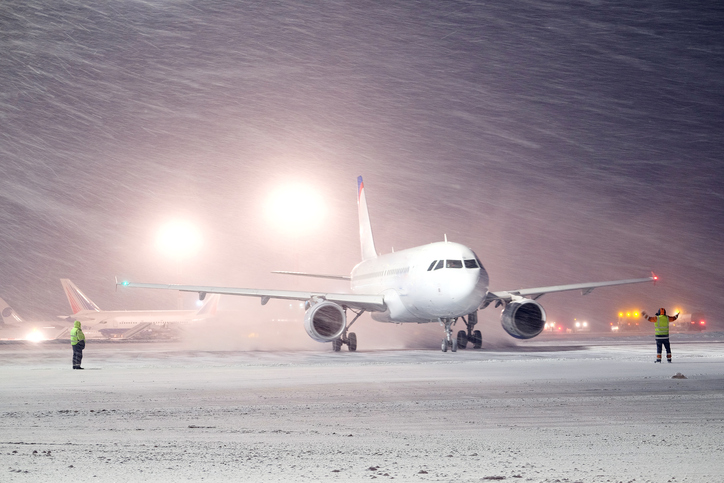 plane parked at the airport in winter