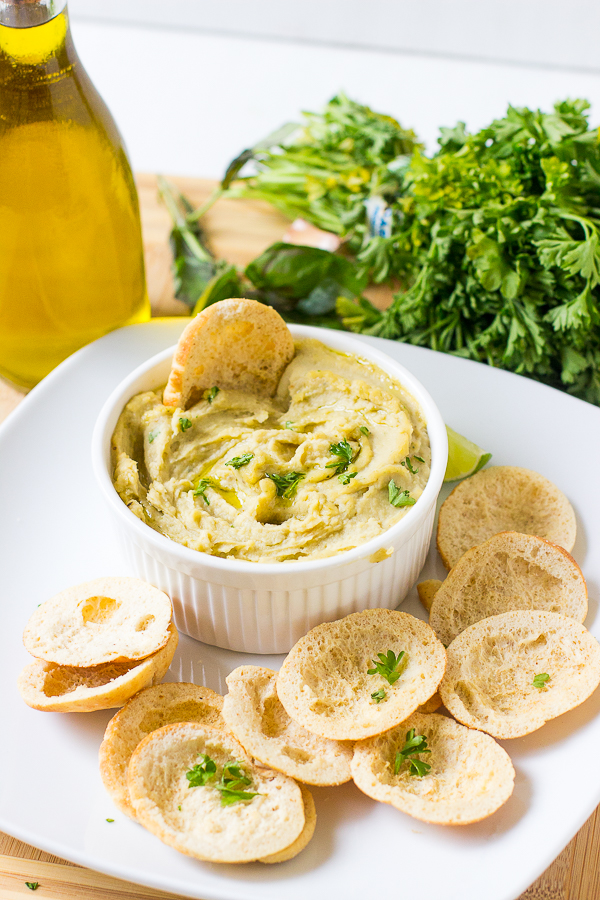 This-Herbed-Roasted-Garlic-White-Bean-Dip-is-ready-in-just-15-minutes-Its-a-delicious-smooth-vegan-dip-that-will-be-perfect-at-your-parties-2.jpg