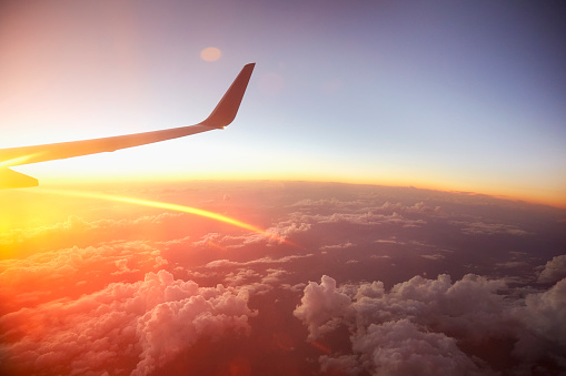 Sunrise over the world from a plane window.