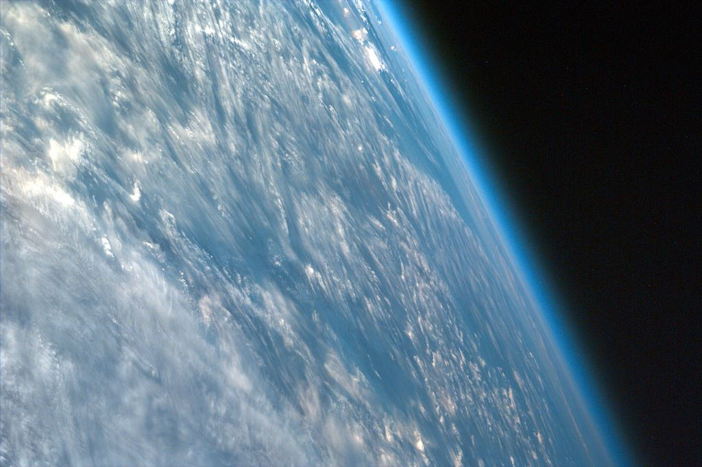 Image shot over northwestern part of the African continent captures the curvature of the Earth and shows its atmosphere. taken from the Space Shuttle