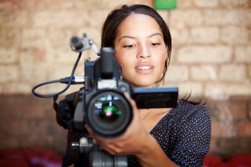 woman behind camera
