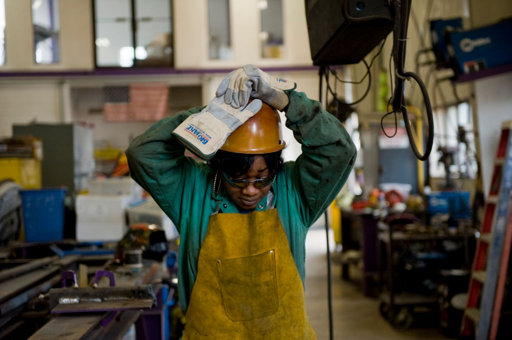 Women like journeywoman ironworker Bridget Booker are the focus of recruitment by  the ironworkers union. Booker is the only Africaan American female in her local.