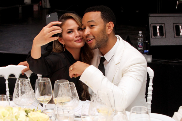 Chrissy Teigen and John Legend Devil Wears Prada