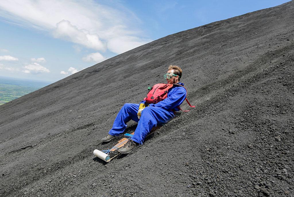guy sandboards down cerro negro volcano in nicaragua