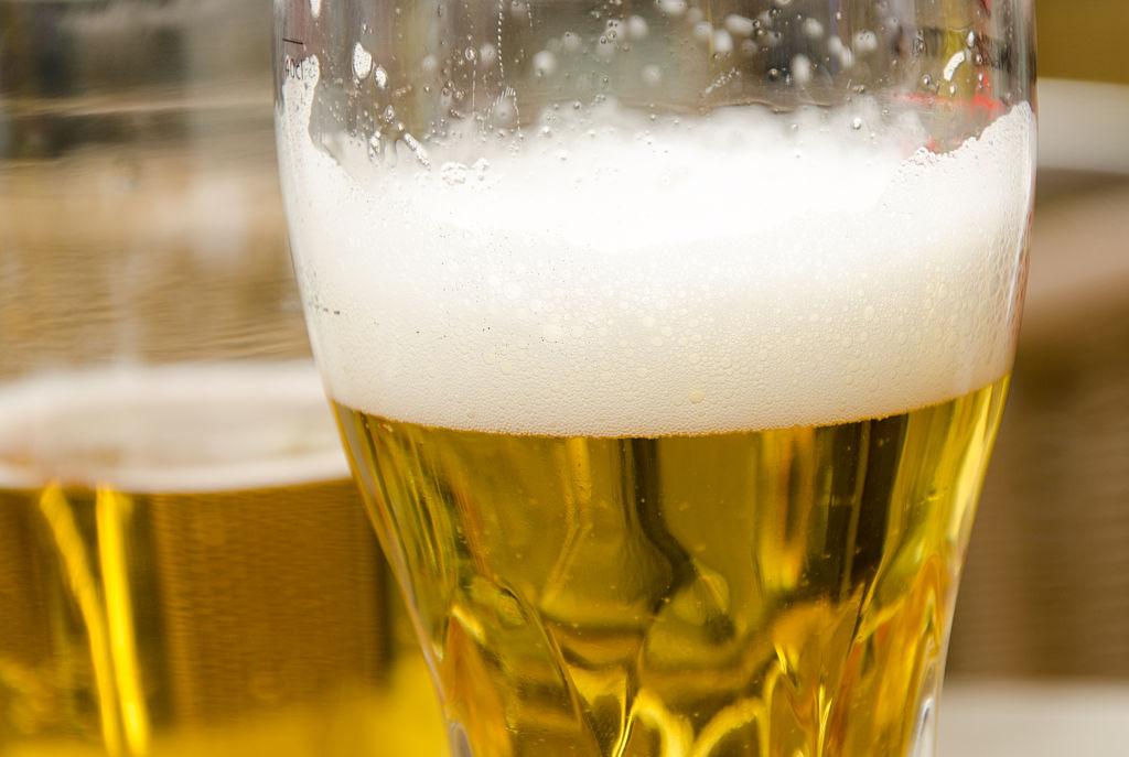 Close-up of half-filled beer glasses on restaurant table