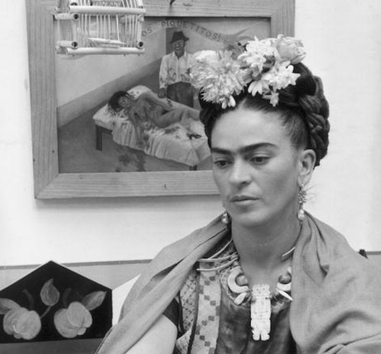 Frida Kahlo in front of one of her pieces of art