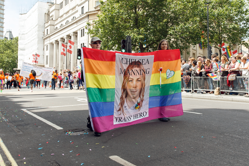 """London Pride Parade flag with """"Chelsea Manning, Trans Hero"""" on it"""