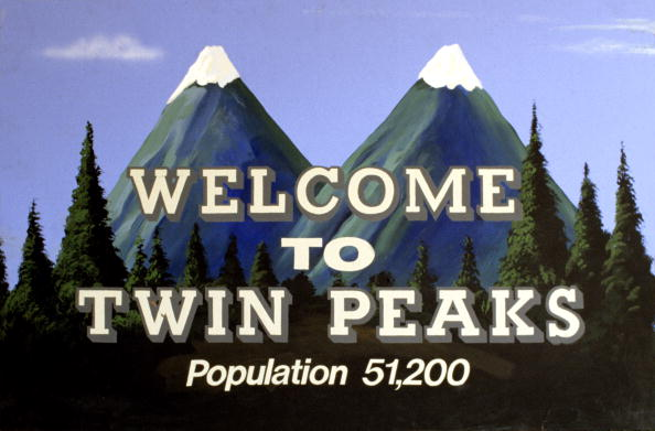 """A photo of a mountain with """"Welcome to Twin Peaks"""" printed atop it"""