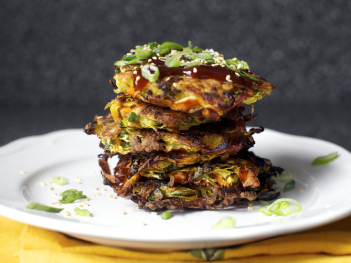 A stack of Japanese style vegetable pancakes