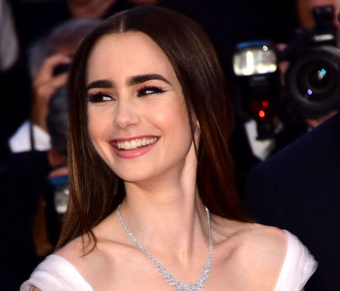 Lily Collins wears hair straight at Cannes.