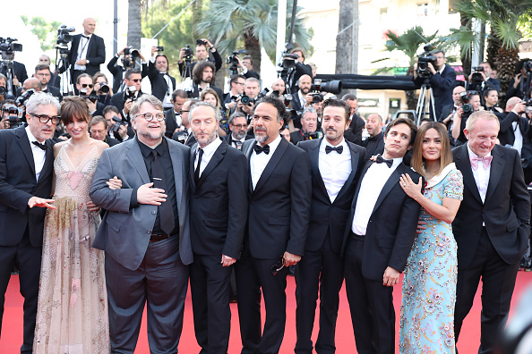 Mexican director Alfonso Cuaron and his partner Sheherazade Goldsmith, Mexican director Guillermo del Toro, Mexican cinematographer Emmanuel Lubezki, Mexican director Alejandro Gonzalez Inarritu, Mexican actor Diego Luna, Mexican actor Gael Garcia Bernal, Mexican-Lebanese actress Salma Hayek and French businessman Francois-Henri Pinault attend the 70th Anniversary of the 70th annual Cannes Film Festival at Palais des Festivals on May 23, 2017 in Cannes, France.