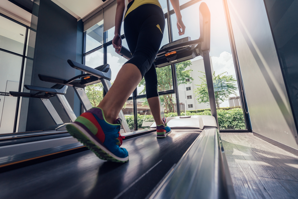 Picture of a woman running on a treadmill.
