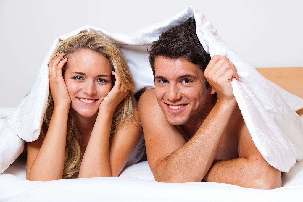 A man and a woman in bed.
