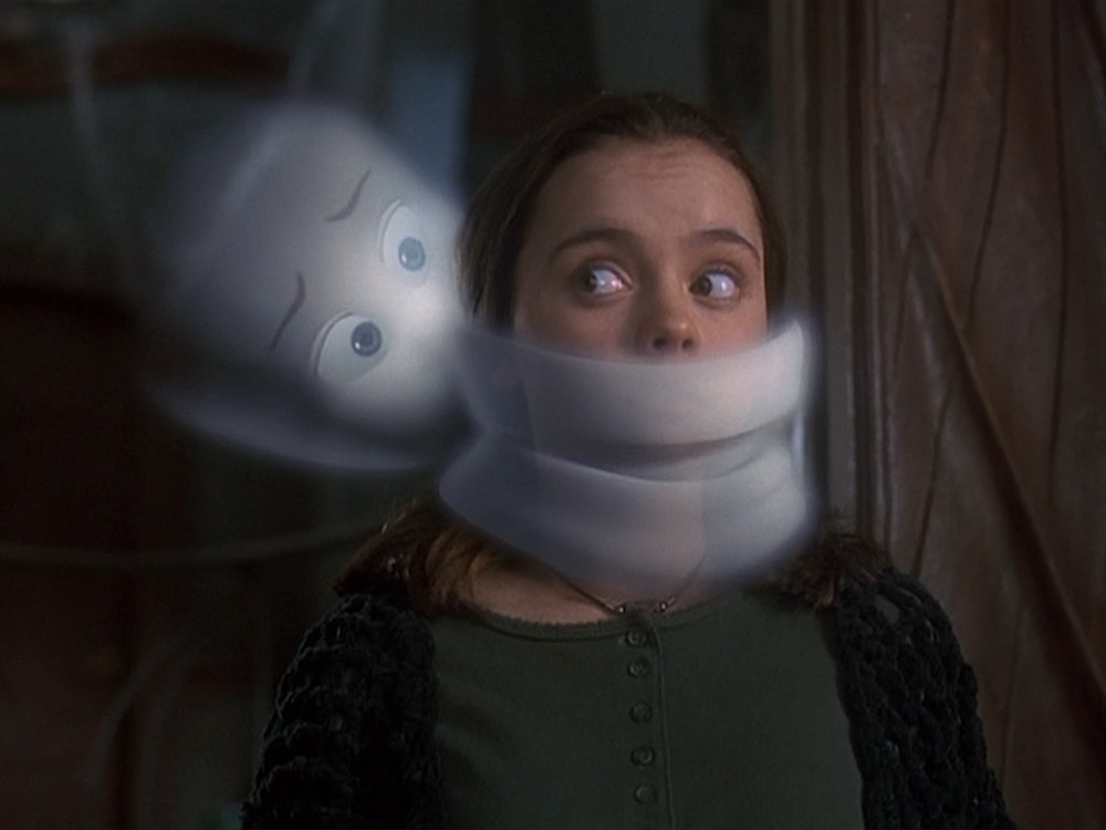 Casper the Friendly Ghost puts himself over Christina Ricci's mouth in a still from the 1995 movie.