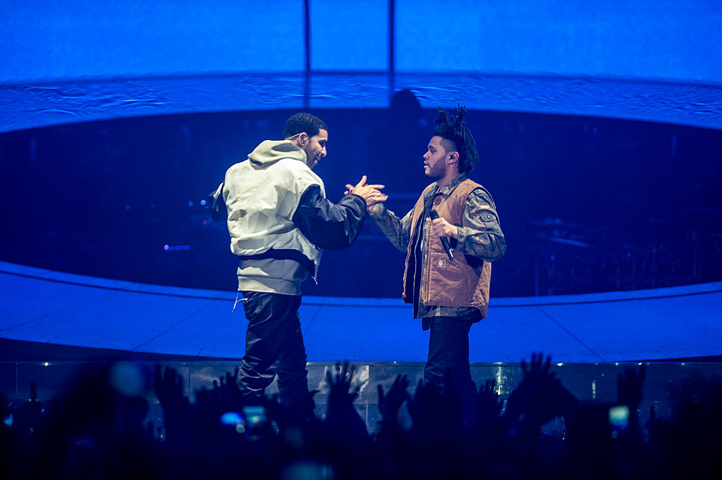 Drake and the Weeknd perform together onstage.