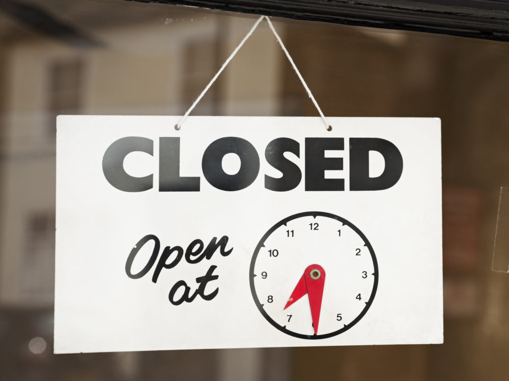 Closed sign on store