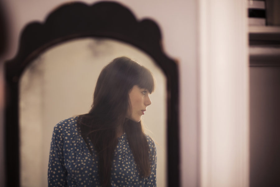 Image of woman in the mirror