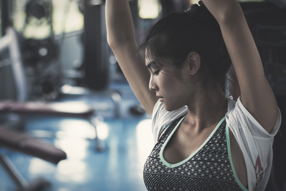Woman sweating at the gym