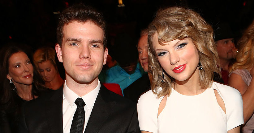 Austin and Taylor Swift sit side by side at the Annual Academy of Country Music Awards