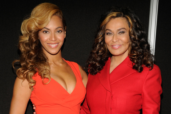 Beyonce and her mother Tina Knowles-Lawson, both wearing red