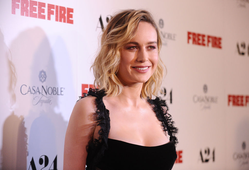Brie Larson wears a black dress on the red carpet.