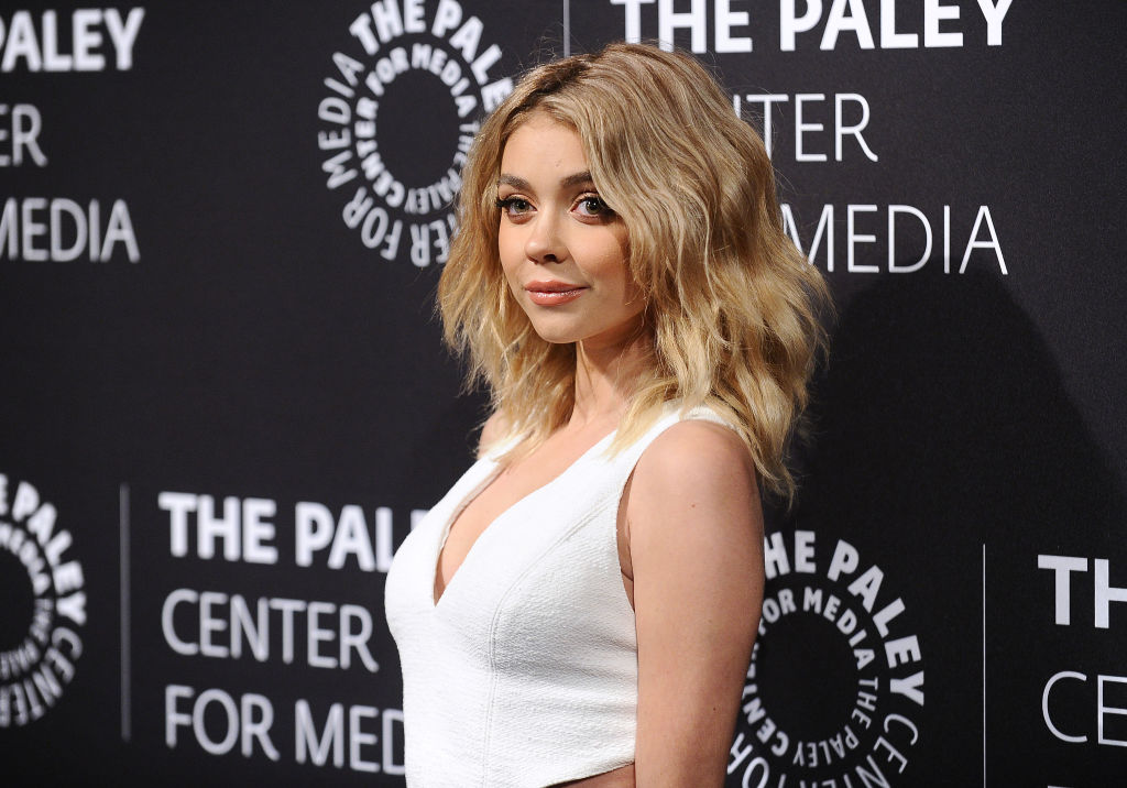Sarah Hyland wears a white dress on the red carpet