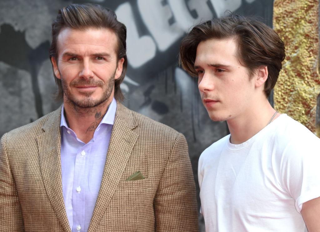 """David and Brooklyn Beckham attend the European premiere of """"King Arthur: Legend of the Sword"""" at Cineworld Empire on May 10, 2017 in London"""