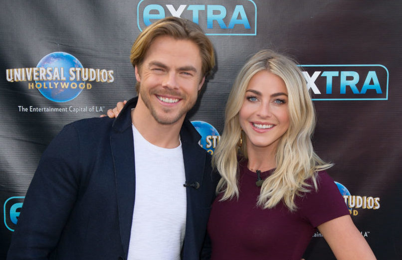 Derek Hough and Julianne Hough pose on the red carpet
