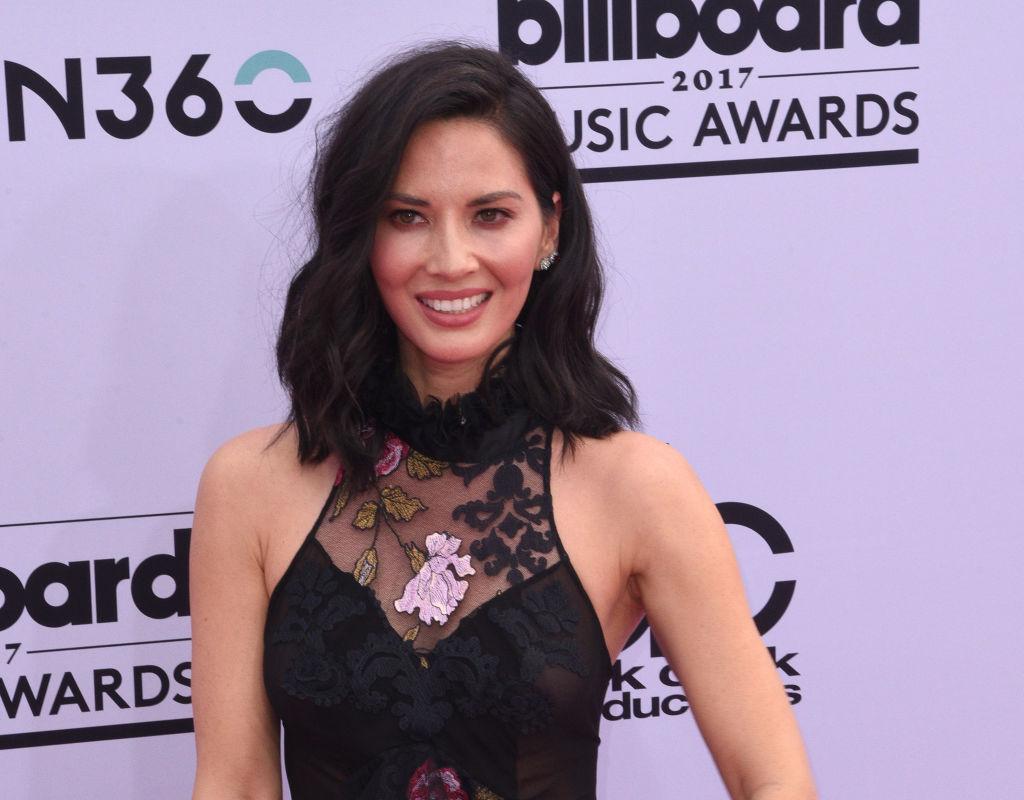 Olivia Munn wears a black dress to the Billboard Music Awards