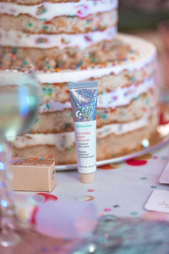 Glossier Balm Dotcom in Birthday Cake with cake