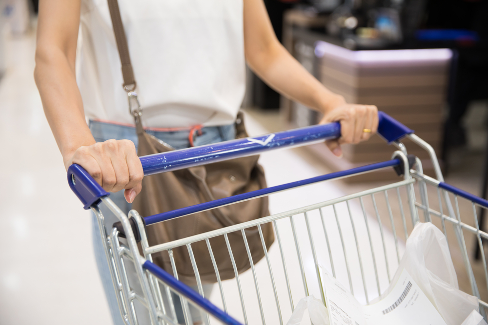 Woman pushing cart in grocery store