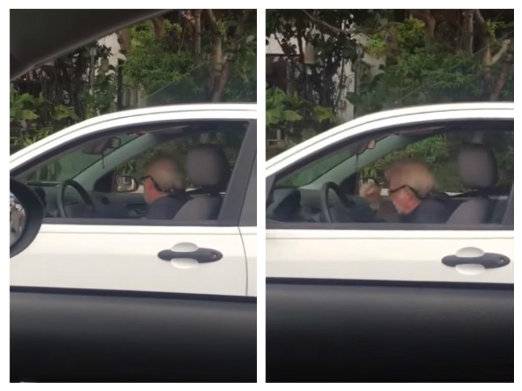 man rocks out to metallica in car