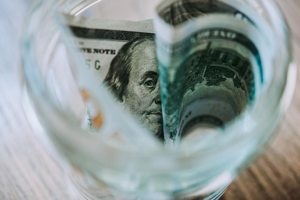 Money in a savings jar.