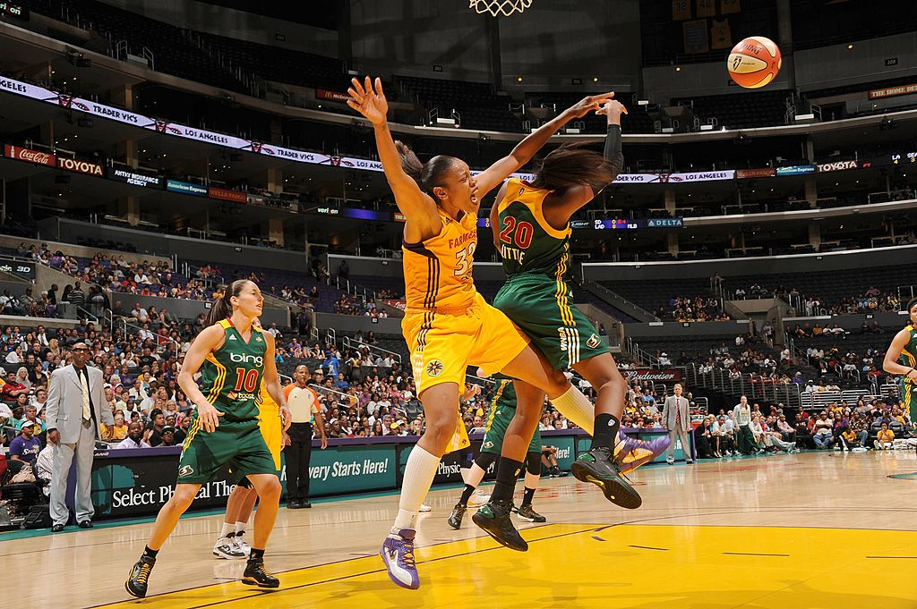 LOS ANGELES - AUGUST 30: Tina Thompson #32 of the Los Angeles Sparks struggles for a rebound against Camille Little #20 of the Seattle Storm at Staples Center on August 30, 2011 in Los Angeles, California. NOTE TO USER: User expressly acknowledges and agrees that, by downloading and or using this photograph, User is consenting to the terms and conditions of the Getty Images License Agreement. Mandatory Copyright Notice: Copyright 2011 NBAE (Photo by Andrew D. Bernstein/NBAE via Getty Images)