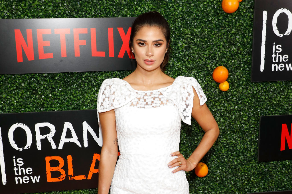 """Diane Guerrero wears white at an event celebrating """"Orange Is The New Black"""""""