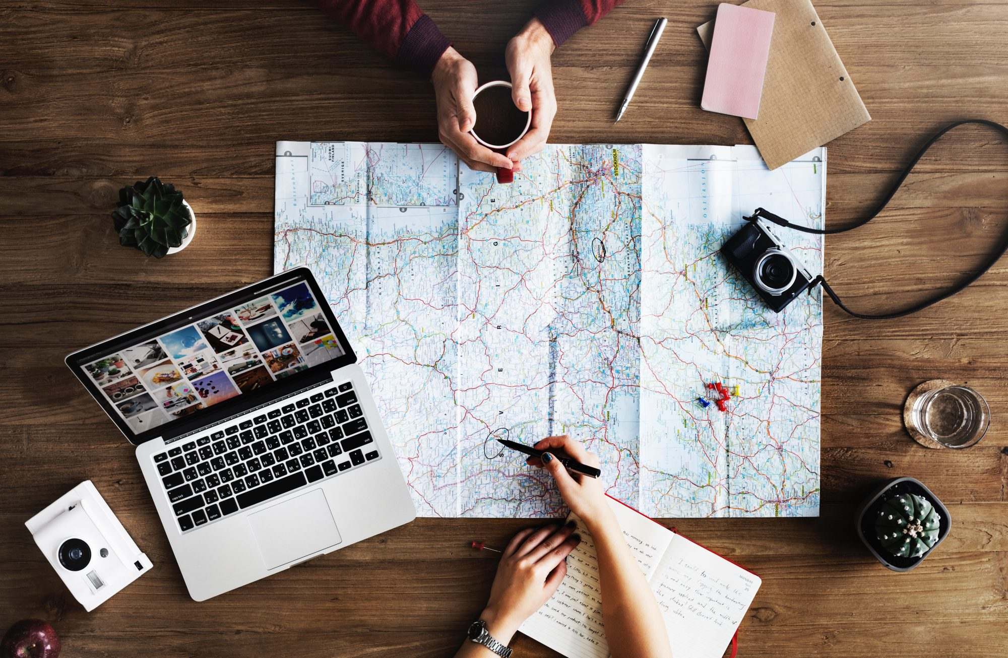 travel plans laptop map camera