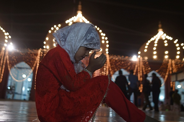 A young girl prays at a mosque