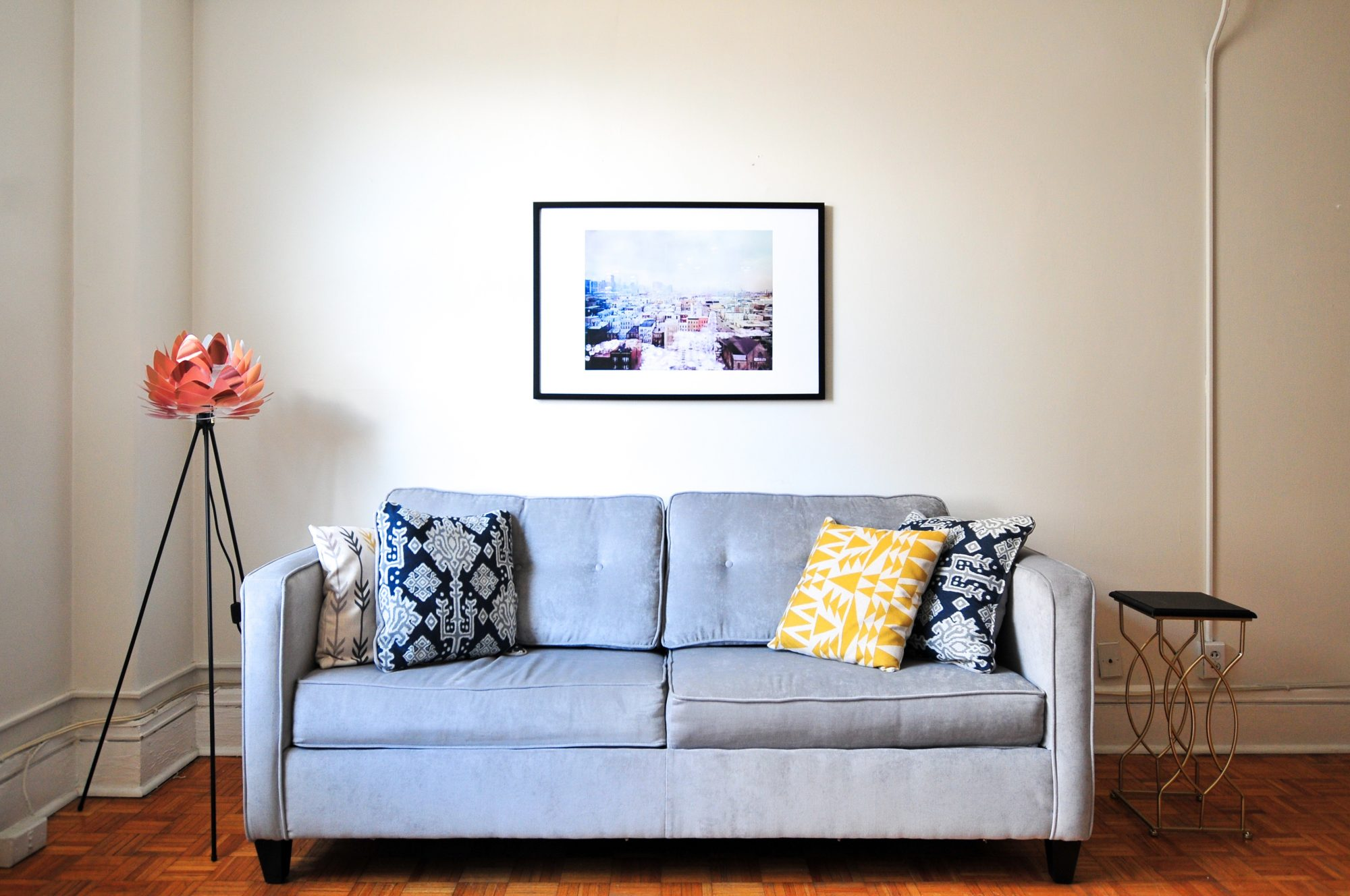 apartment furnished with gray couch pillows painting