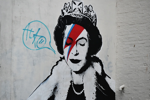 A graffiti piece is seen on a building near Stokes Croft on October 21, 2015 in Bristol, England. Stokes Croft and surrounding areas in Bristol are renowned for their graffiti and street art scene. The piece is by the street artist Banksy. (Photo by Rufus Cox/Getty Images)