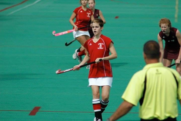 Emma Watson playing field hockey