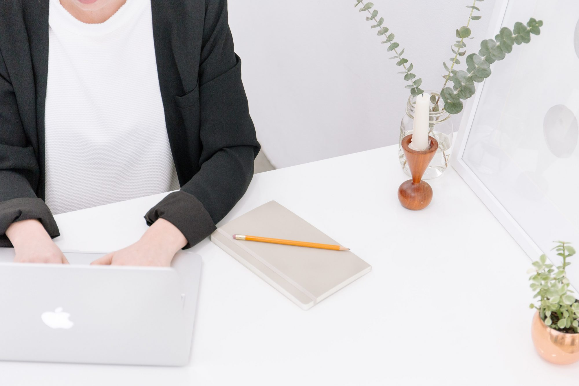 woman at a desk typing on laptop