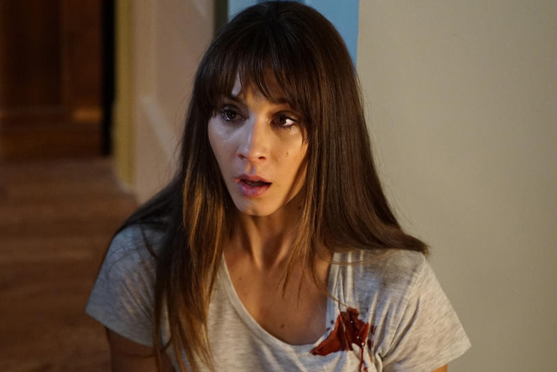 Trojan Bellisario as Spencer Hastings in Pretty Little Liars gasps while covered in a spot of blood
