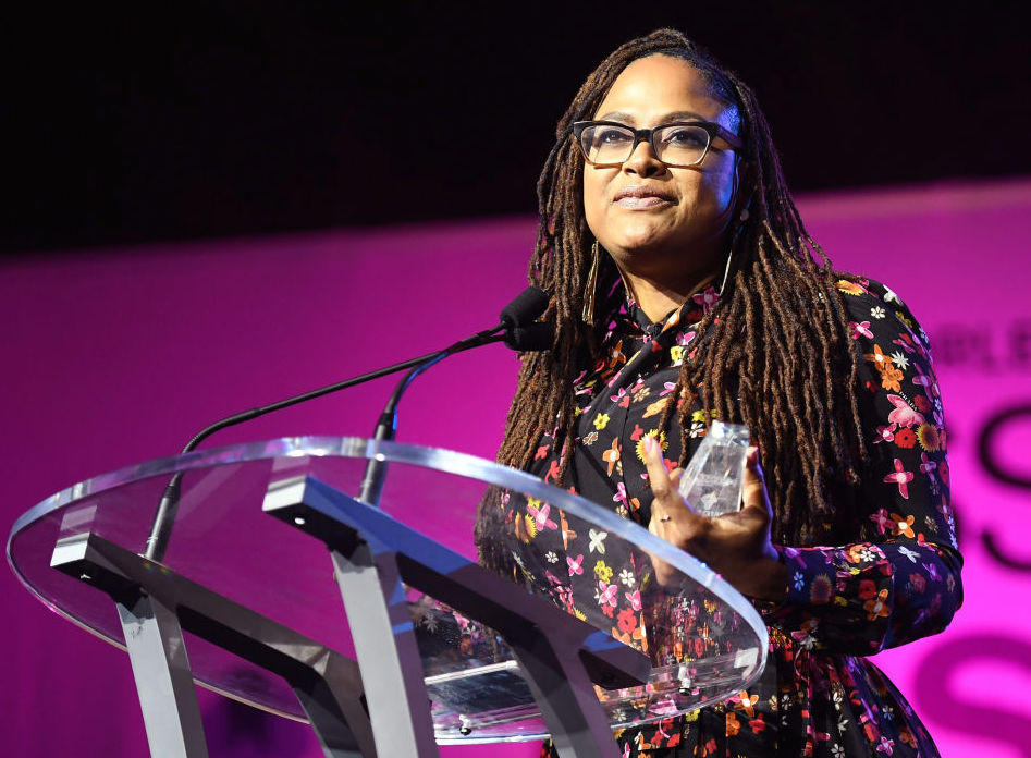 Ava DuVernay speaking at podium onstage at the 2017 ESSENCE Festival