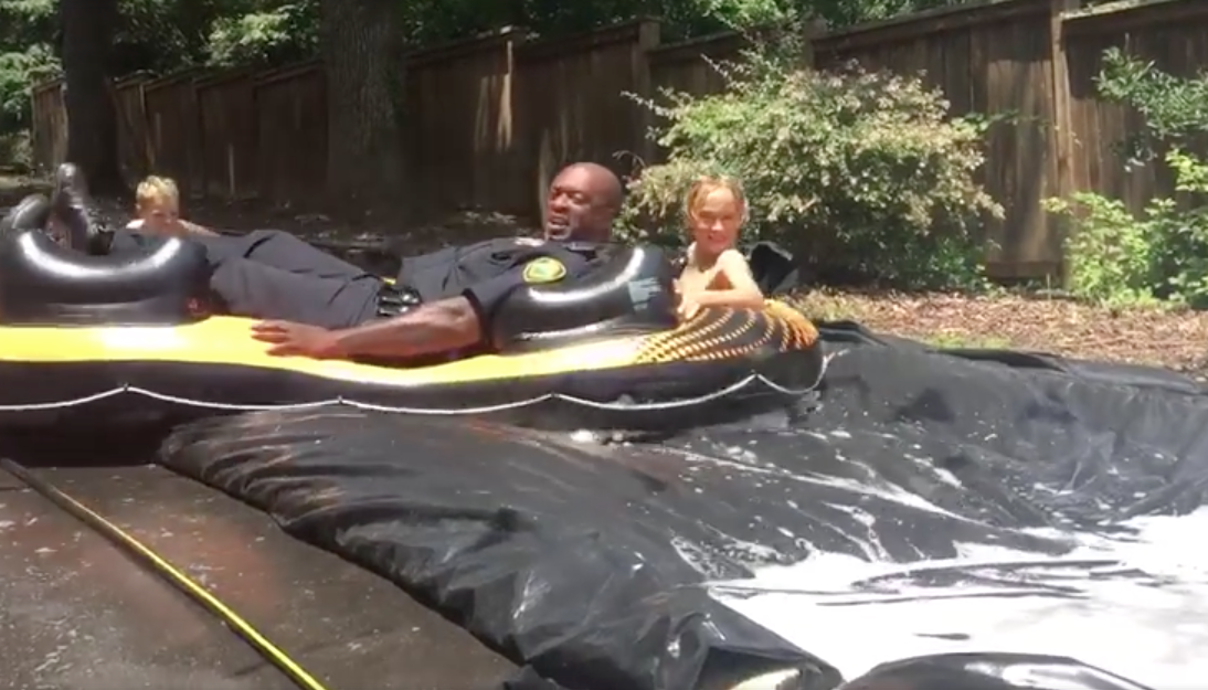 Image of cop on slip-and-slide