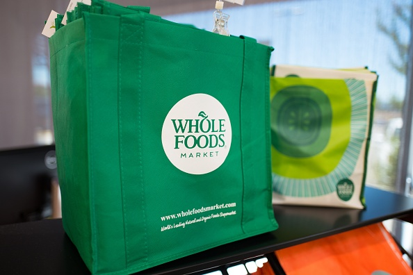 Reusable shopping bag with logo at Whole Foods Market grocery store in Dublin, California, June 16, 2017. On June 16, 2017, Amazon.com announced that it would acquire the upscale grocery chain. (Photo via Smith Collection/Gado/Getty Images).