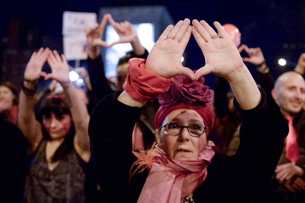 Demonstrator gestures during a rally for International Women's Strike. Marchers calling for the end of the violence on women and equal rights.