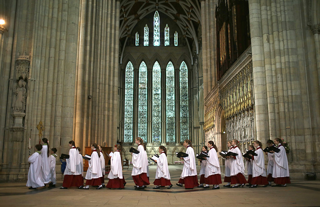 YORK, ENGLAND - JULY 13: The choir process through York Minster during a Eucharist Service attended by the Church of England Synod on July 13, 2014 in York, England. Members and officers of the Church of England's General Synod are preparing for a vote on whether to introduce women bishops. The Synod will vote tomorrow during it's meeting at York University and if successful women bishops could be announced later this year. (Photo by Christopher Furlong/Getty Images)
